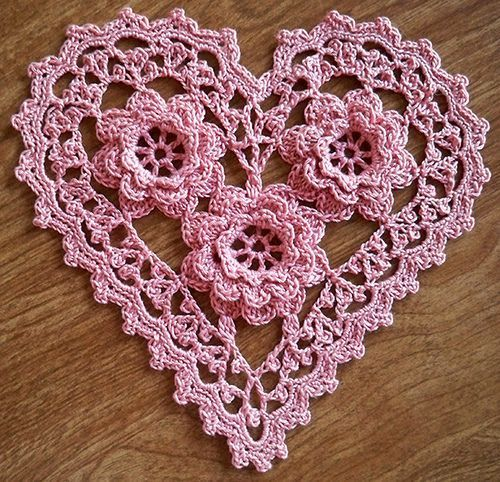 """Irish Crochet Roses Heart by LaceCrochet on Flickr """" Slight variation of """"Rose Heart Sachet"""" from Woman's Day Granny Squares No 8. The bottom rose in the photo has nine petals around the edge, instead..."""
