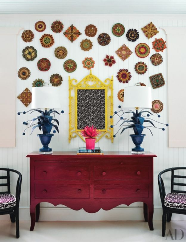 Luxe hotel tour: Playa Grande Beach Club, Dominican Republic: Vintage trivets join a wicker mirror in one of the children's rooms; the lamps are by Stray Dog Designs.