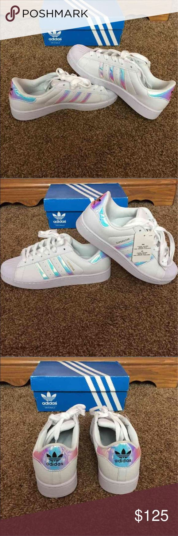 *OFFERS* Holographic Adidas Superstars Gorgeous limited edition adidas superstars. This is super RARE and no longer made so grab it while you can. Brand new with box. Will accept reasonable offers made with the offer button. I do not trade.                                                            Men's 7 or Women's 8                                                 Less on Ⓜ️ercari Adidas Shoes Athletic Shoes