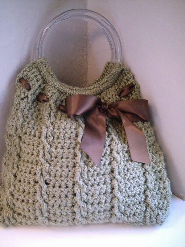 The ribbon gives this crocheted bag a cute characteristic, along with the clear handle. Tote this piece with you everywhere you go!
