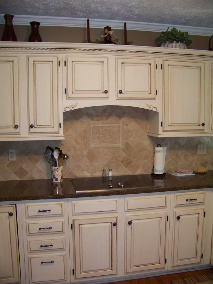 Cream cabinets with dark brown glaze diy refinish for Antique ivory kitchen cabinets