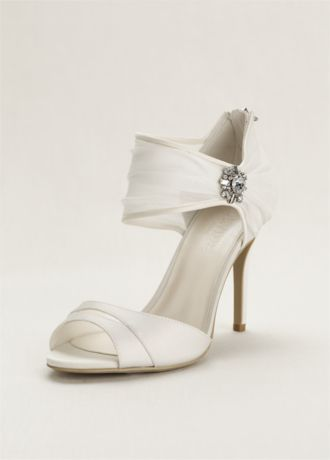 Create major shoe envy with these unforgettably chic chiffon ruched sandals!  High heel sandal features gorgeous chiffon ruching over the ankle strap.  Ultra-luxe crystal embellishment adorns the side of the ankle strap for some extra sparkle.  Heel Height - 3 1/2 inches.  Available in Ivory. Fully lined. Back zipper. Imported.