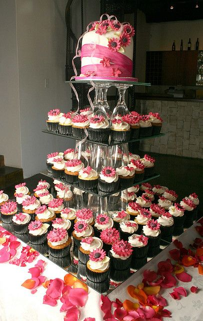 Cupcake stand, using glasses. Would add battery votives under the glasses for fire, & proper icing colors.