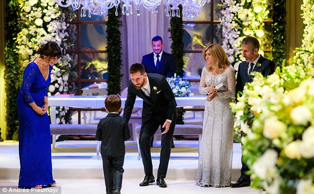The couple already have two sons, Thiago (pictured walking down the aisle) and Mateo