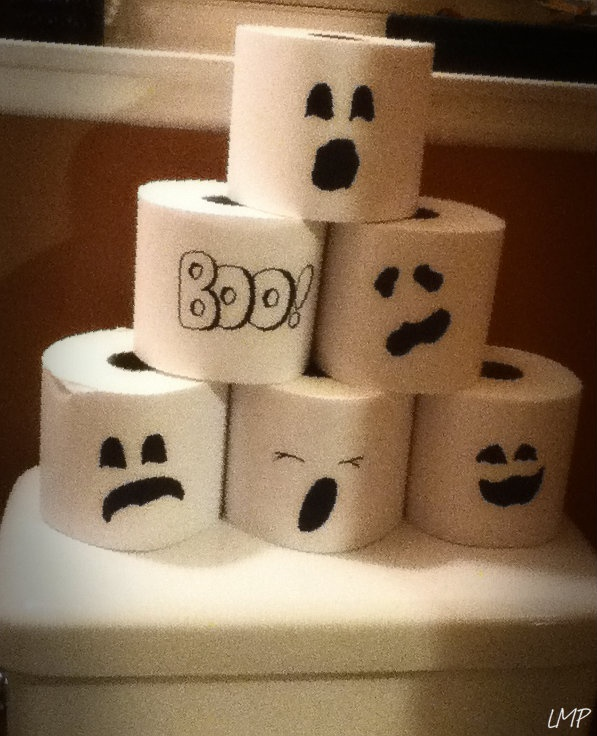 Spooky TP: Wrap toilet paper in white printer paper(tape shut in back) and draw fun ghost faces to had festive fun to the bathroom, great craft for kids, and also a good way to distract from the extra toilet paper on the back of the toilet.