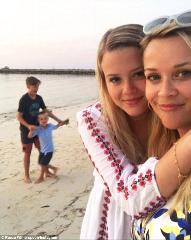 Beach time: The actress shared this snap of herself with daughter Ava, 17, and son Deacon, 13 - her kids with ex Ryan Phillippe - and Tennessee, four, her son with agent husband Jim Toth