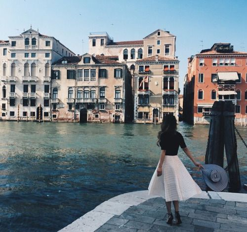Italian exploring   canals and rivers   long striped skirts and big hats