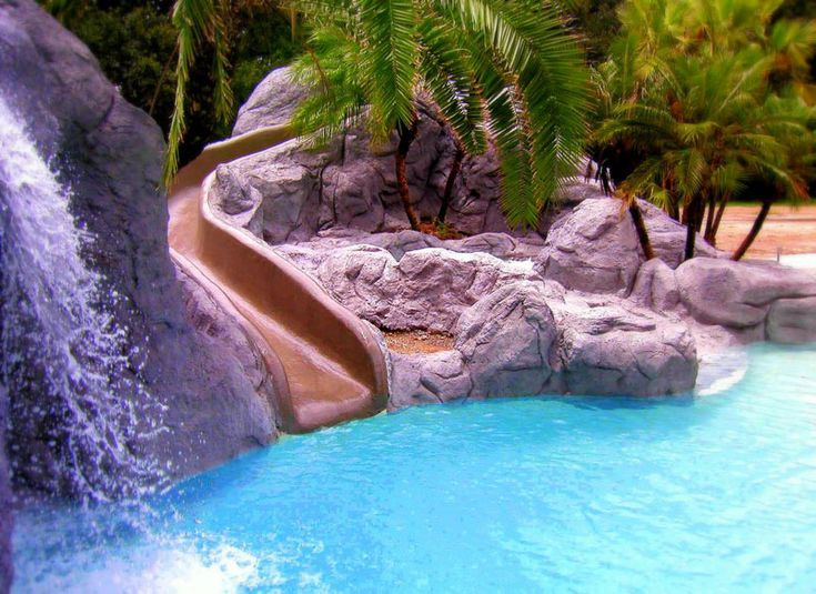 Cool Pools With Waterfalls And Slides swimming pool designs with slides photo 5. natural swimming pools