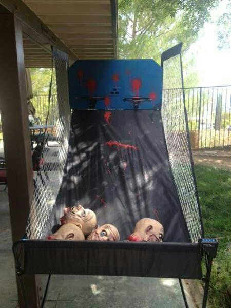 """Halloween Carnival Theme Party, basketball game~excellent! maybe make it for football? With a canvas """"throw net"""" and heads."""