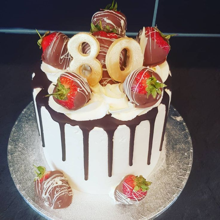 80th birthday cake topped with chocolate covered