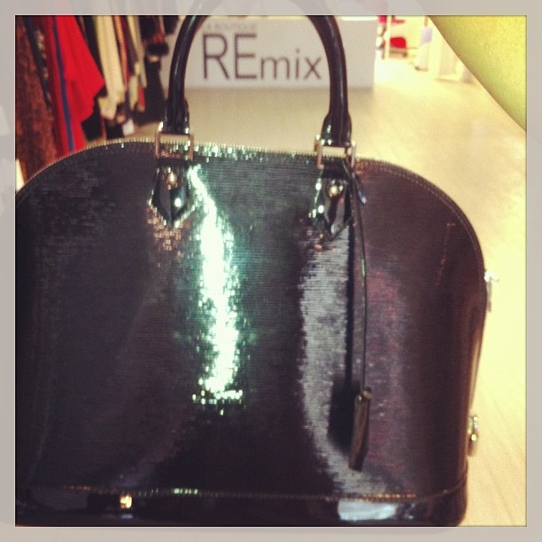 Hot Alma LV bag in Epi leather ! Make this yours, the epitome of elegance and class for only 1999!! #mtl #montreal #remixmontreal - @remixclothing- #webstagram