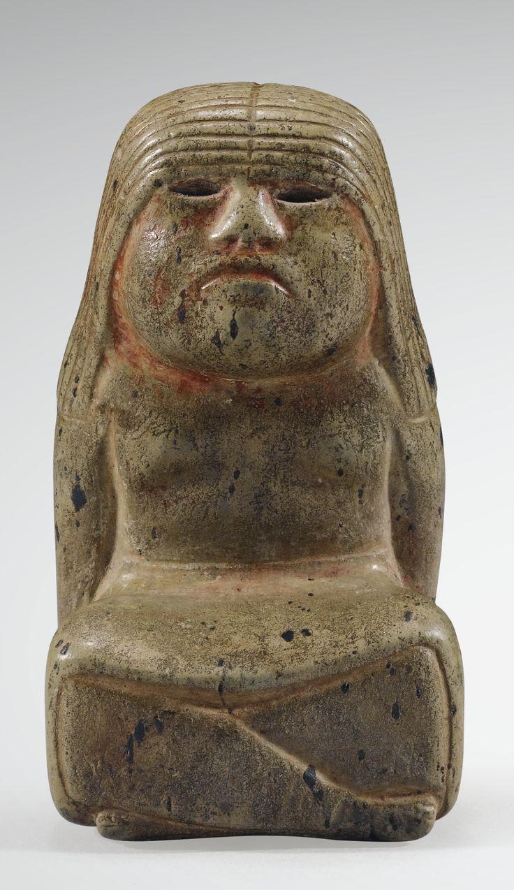 STATUETTE FÉMININE ASSISE  CULTURE OLMÈQUE  GOLFE DU MEXIQUE  PRÉCLASSIQUE, 900-600 AV. J.-C.  OLMEC STONE SEATED FEMALEFIGURE, GULF OF MEXICO