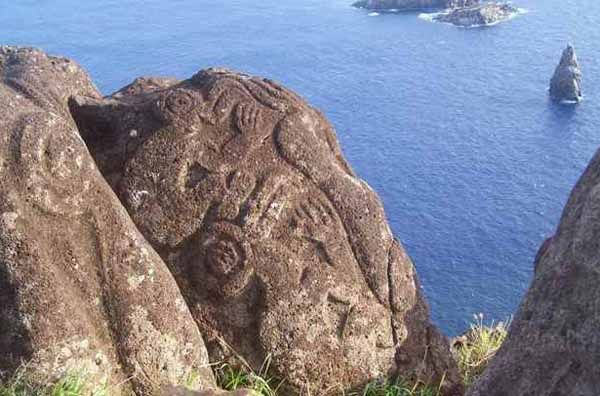Rapa Nui (aka Easter Island) has petroglyphs, not just statues. whole carved rock outcroppings. very cool.