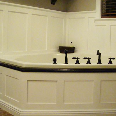 wainscoting bathroom tub - my tub sits just like this. I could get rid of the ugly doors and the tile.