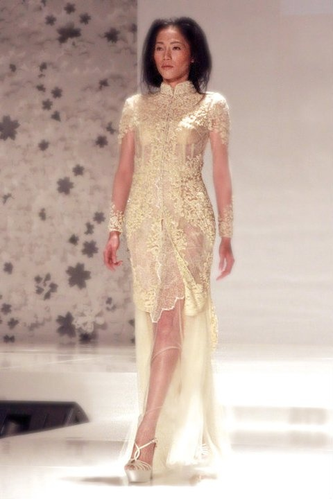 Runway Images : Sapto Djojokartiko Bride 2011 | Long sleeve illusion hem wedding dress.