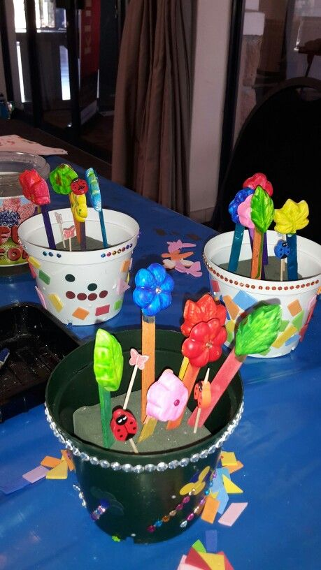 Ceramic flowers, in pots. For this fun craft , the children first decorated the flower pots with foam mosaic and stickers. Then they painted ceramic flowers (glued onto craft sticks) we accessorised with lady birds and butterflies. The perfect craft for spring.