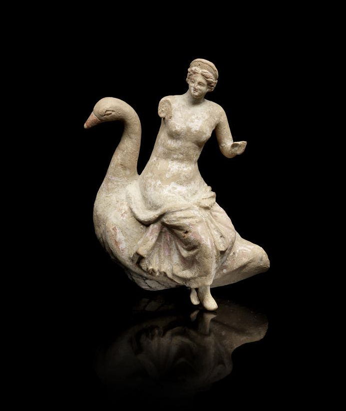 A Greek terracotta group of Aphrodite on a goose. Hellenistic Period, circa 2nd-1st Century B.C. - Or Leda and the Zeus as a swan, the bird with the a long curving neck, the goddess depicted seated on the back of the bird, with drapery around her lower body and wearing a stephane in her hair.| © Bonhams 2001-2014