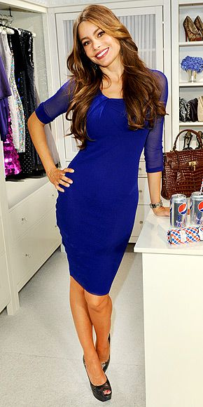 Sofia Vergara in a sheer-sleeved blue dress, sported with platform Stuart Weitzman peep-toes and wavy locks at a Diet Pepsi event in N.Y.C.