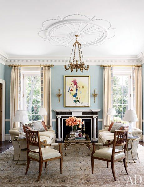 Elissa Cullman ~ A Hans Hofmann painting hangs above a custom-made Jamb mantel in another part of the living room; Biedermeier armchairs from Karl Kemp Antiques stand on a circa-1920 Tabriz carpet from Galerie Shabab.