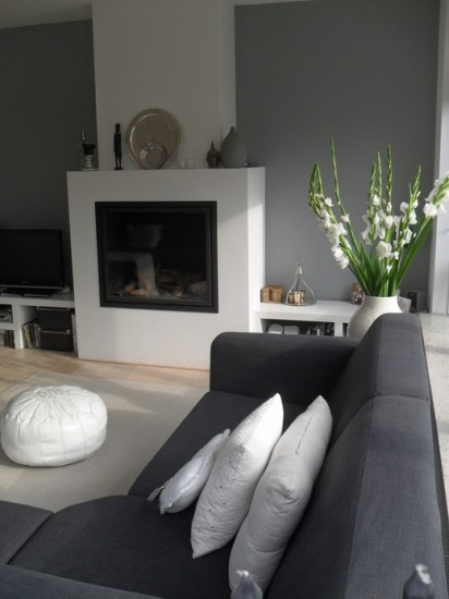 bluegrey sofa and white fireplace