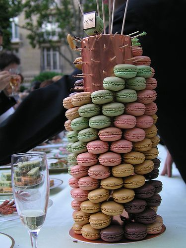 Macaroon Tower; dessert table.this idea would work with alot of other foods too