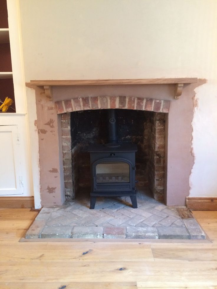 http://www.colnestoves.com Lovenholm multi fuel stove fitted by one of own teams of fitters, call 01284 388188 for further details.