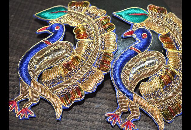 Peacock Appliques with mirror work are extremely beautiful sew on applique in golden finish which gives the exclusive look. Each of them is decorated with Red Silk Thread, Mirrors, Zardozi work,...