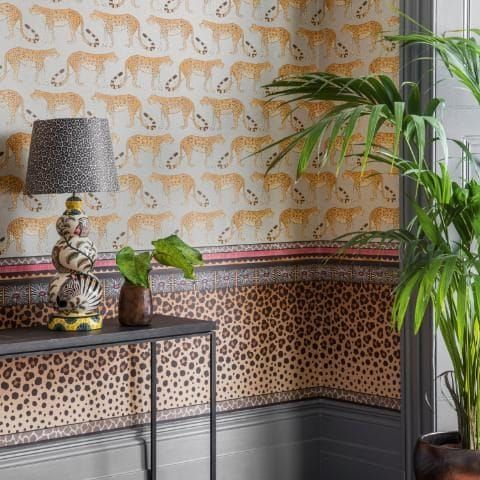 Leopard Walk wallpaper with Zulu Border, part of The Ardmore Collection for Cole & Son wallpapers