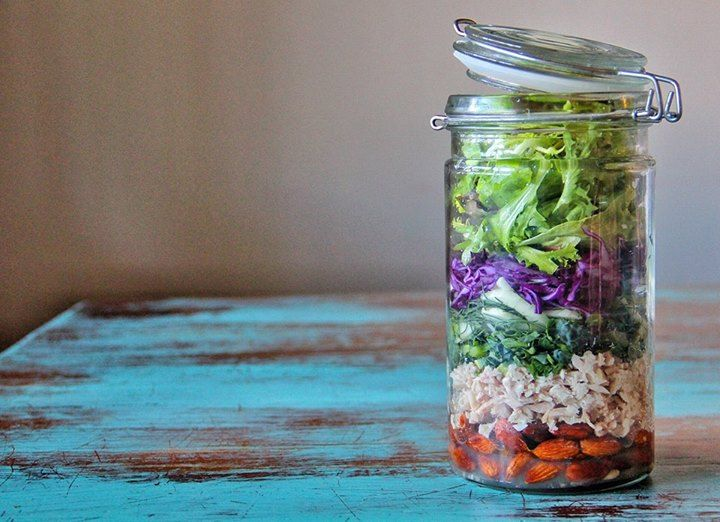So this is my lady Zoe's all you can eat salad jar. Tuna, almonds, purple raw cabbage, kale, fennel and lettuce with a lemon and olive oil dressing. Put the dressing, tuna and almonds in first so the softer items don't get soggy and then simply tip it upside down to serve. Maybe even call it a 'rainbow jar' by adding other colorful vegetables and make it fun for kids.