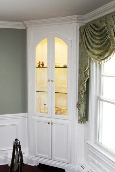 Corner china cabinet built-in.  Simple  with beautiful molding Remember to run electricity!