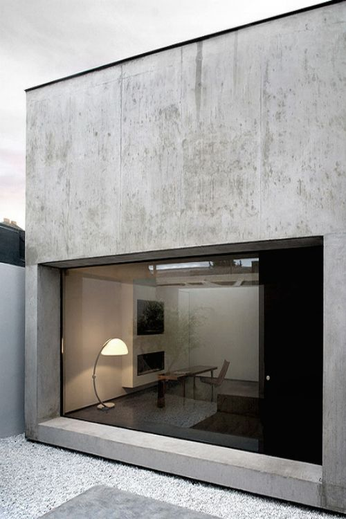 I like the low set big window and the lamp...but not the concrete.