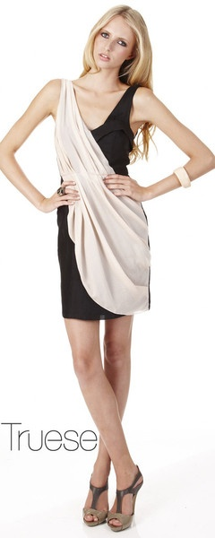 The Truese Breeze dress is a classic. Black & cream are teamed so well together! We love this dress & its on sale now x