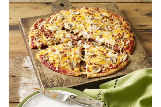 Everything is better with bacon, including our Bacon-Mushroom Pizzeria Pizza recipe.  Our homemade Perfect Parmesan Pizza Dough is topped with pizza sauce, cheese, mushrooms, onions and bacon - yum!