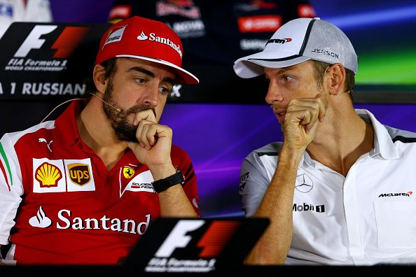 Fernando Alonso of Spain and Ferrari speaks with Jenson Button of Great Britain and McLaren during a press conference during previews ahead of the Russian Formula One Grand Prix at Sochi Autodrom on October 9, 2014 in Sochi, Russia