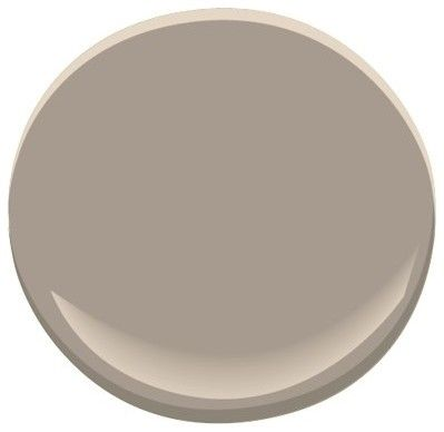 This is a nice warm grey  Ben. Moore  Shenandoah Taupe AC-36 Paint see it here   http://www.houzz.com/photos/14799828/Snoqualmie-Ridge-transitional-family-room-seattle