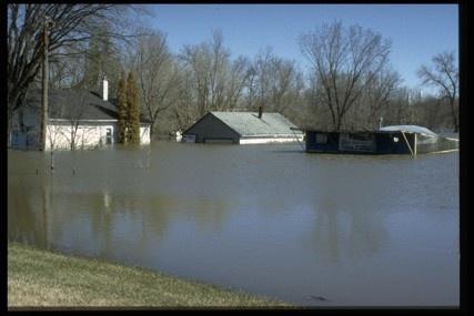 Winnipeg 1998 - Flood of the Century.  Flooded house on Pembina Highway shown here.