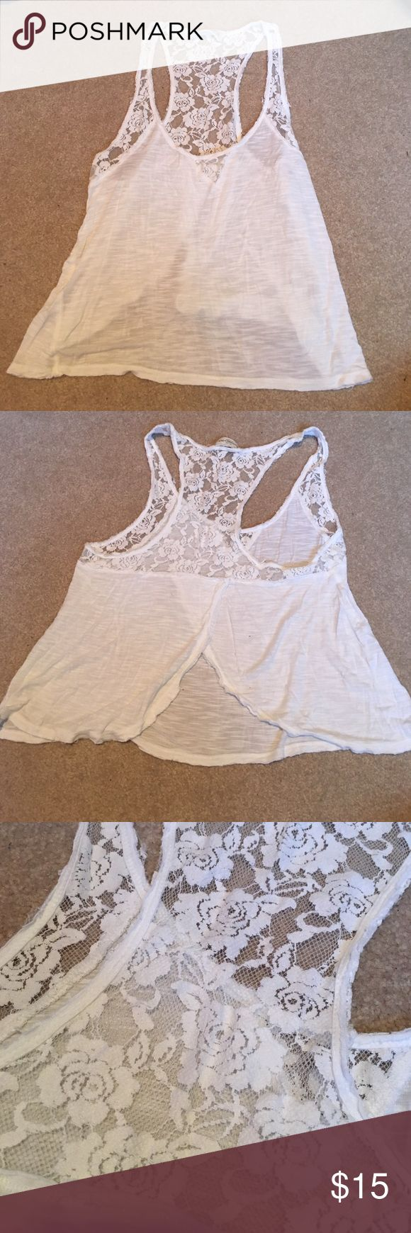 Abercrombie and Fitch tank top Abercrombie and Fitch white tank top. Size large. Really super cute. The back cuts open and too had lots of lace. Would look super cute with bralette underneath. Willing to negotiate price. Abercrombie & Fitch Tops Tank Tops