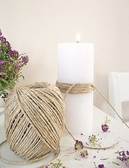 Twine around candle. outdoor, natural wedding centerpieces. This could be pretty next to a basic bouquet of lavendar or wildflowers.