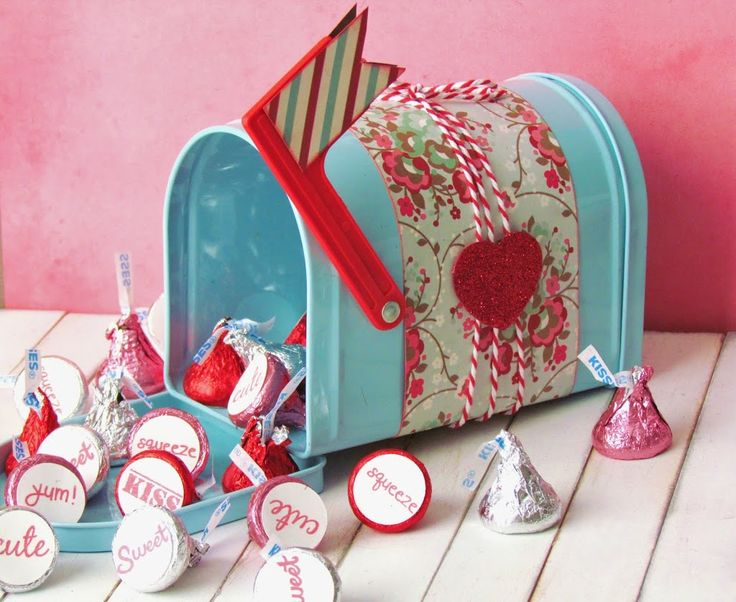 Chocolate Kiss Delivery.  Tin mailbox embellished with paper with stamped kisses inside.