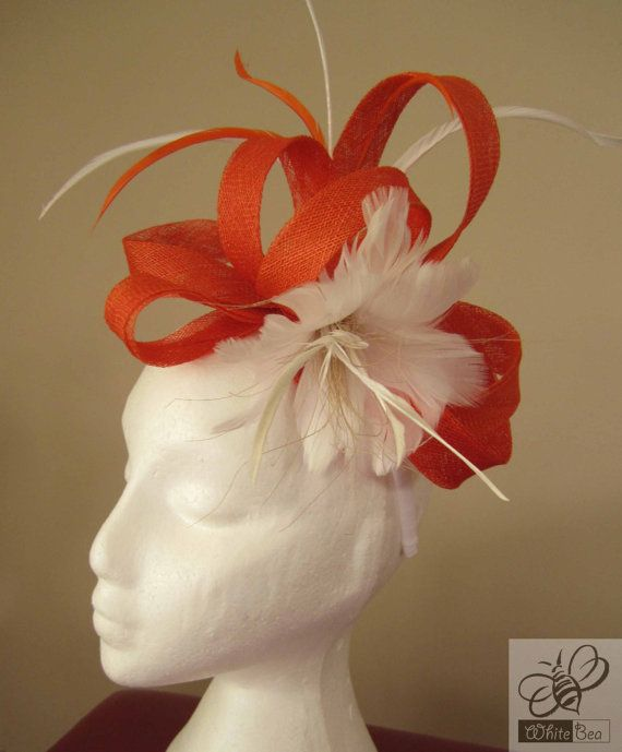 Fascinator with orange sinamay and white feather by WhiteBea