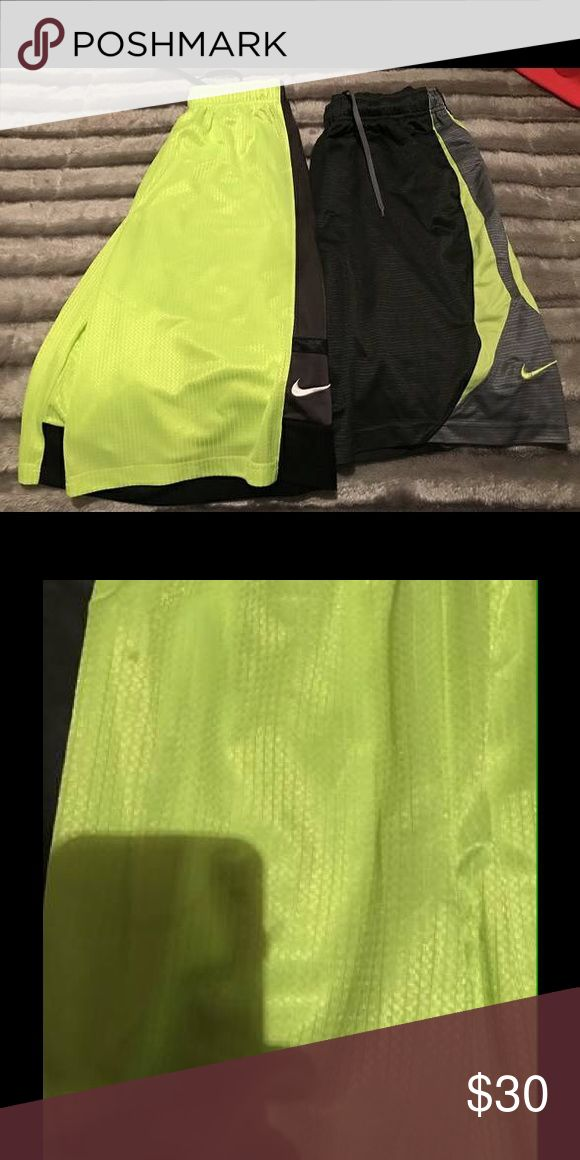 Two Boys Nike Shorts They are both a size large, one is bright yellow, has some slight stains on it but everything else look great, other is dark grey, no holes or stains, in great condition, both for 30! Nike Bottoms Shorts