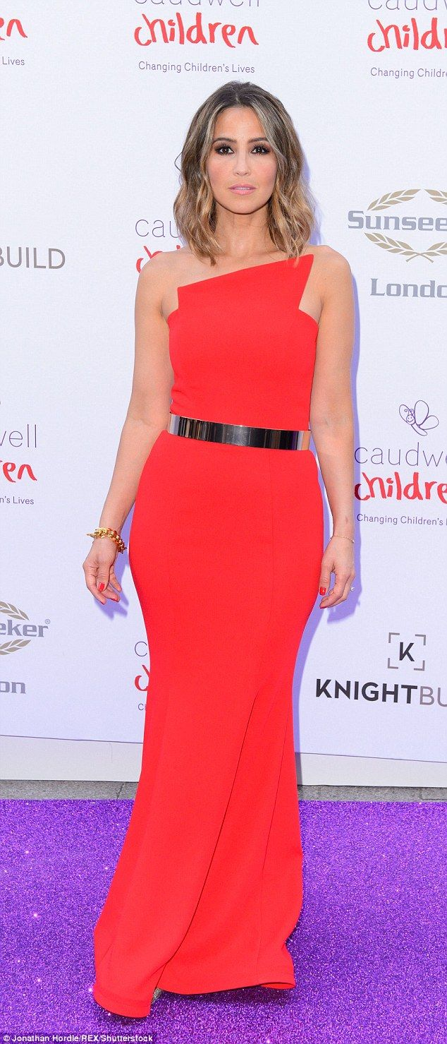 Lady in red: Rachel Stevens oozed opulence in a scarlet strapless creation at the Caudwell...