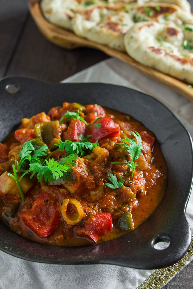 A delightfully flavorful curry with tender juicy chunks of chicken in a spicy tomato sauce studded with stir-fried peppers and onions, Chicken Jalfrezi comes together in under 30 minutes.