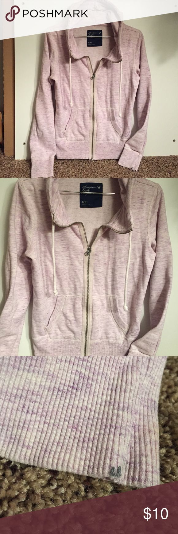 Light purple zip up hoodie American eagle light purple zip up Hoodie. In great condition. Does have small grey paint mark on left hand. As seen in pic 3. American Eagle Outfitters Tops Sweatshirts & Hoodies