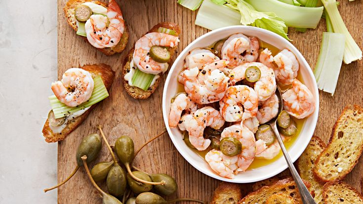 For an unconventional pre-turkey bite, serve a seafood appetizer at Thanksgiving. This dish is the love child of two retro hors d'oeuvres: relish trays and shrimp cocktail. Build-your-own crostini topped with quick-pickled shrimp and vibrant fixings will tide people over and wake up their taste buds.