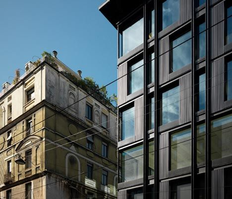Milan, Italy... Italian studio Park Associati has overhauled a 1960s office block in Milan and added new glass and burnished aluminium facades