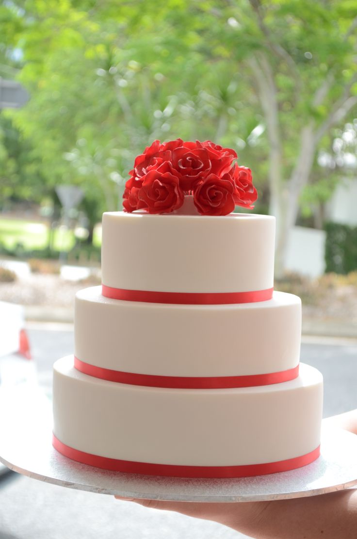 Three tier fondant with red ribbon detail