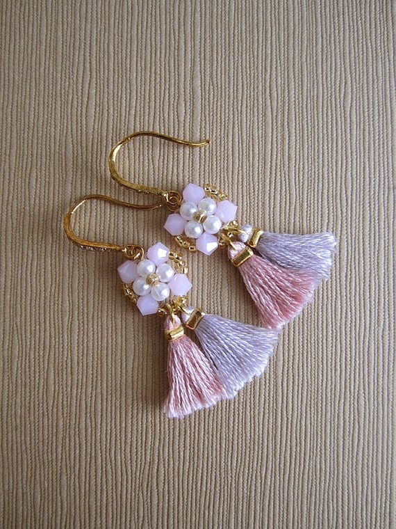 This pair of pink beaded tassel earrings is my version of Bohemian earrings with a delicate feminine twist. It is In making this pair of earrings, the pearls and Swarovski crystals are beaded together to form the top component, then the tassels are handmade and attached to it. This is a beautiful pair of earrings for those ladies who love the soft feminine pink color. To see other color options of this pair of earrings, please click this link: http://etsy.me/2pASltG *********...