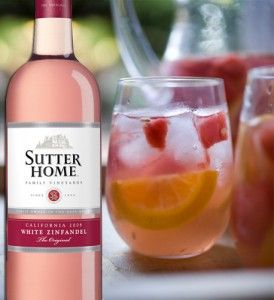 Sutter Home White Zin.  Laura's Sangria (big batch!)  -Sutter Home White Zinfandel – 1 bottle (750ml)  -1 cup peach schnapps  -1/2 cup vodka  -2 cups white cranberry peach juice  -Fruit ice cubes (add slices of peaches, strawberries, oranges, etc into your ice cube trays, fill with water & freeze)  Combine ingredients over fruited ice & serve out of a drink dispenser or pitchers