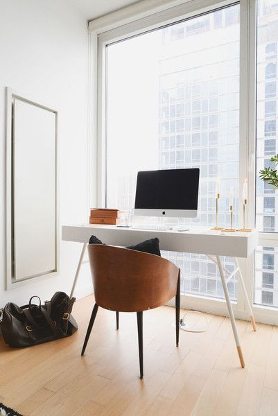 Noa Santos Manhattan Apartment: A midcentury desk—paired with a vintage barrel chair—in the bedroom makes for a discreet home workstation.